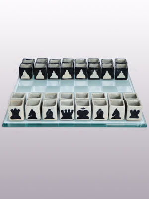Sale Items / Ceramic Tequila shots drinking chess set / The thinking man's drinking game. This beautifully handcrafted chess set is a fun way to compete with your friends at a party and a great conversation starter. Just fill them up with your favorite drink and whenever someone losses a piece they have to drink it in a single shot.