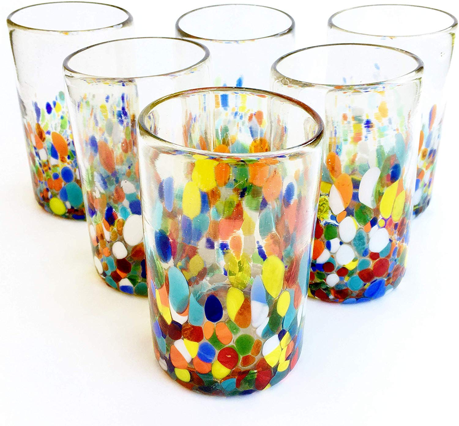 New Items / Clear & Confetti drinking glasses  / Our Clear & Confetti drinking glasses combine the best of two worlds: clear, thick, sturdy handcrafted glass on top, meets the colorful, festive, confetti bottom! These glasses will sure be a standout in any table setting or as a fabulous gift for your loved ones. Crafted one by one by skilled artisans in Tonala, Mexico, each glass is different from the next making them unique works of art. You'll be amazed at how they make having a simple glass of water a happier experience. Each glass holds approximately 14 oz of liquid and stands a bit over 5