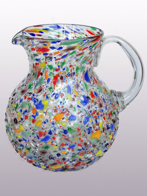 Sale Items / MexHandcraft Blown Glass Large 118oz Confetti Rocks Multicolor Pitcher / Confetti rocks appear to rest inside this modern blown glass pitcher that will make your table setting shine. Each pitcher is adorned with hundreds of tiny multicolor glass particles, giving it a one-of-a-kind look and feel.